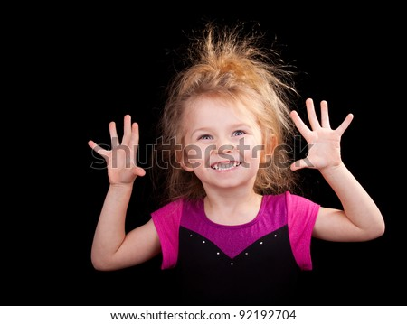 Cute image of a child with crazy hair. - stock photo