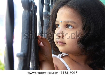 Cute Indian Girl Looking up With Smile - stock photo