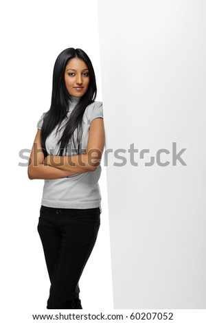 Cute Indian woman presents with a blank white board - stock photo