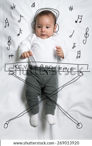Cute infant baby boy sketched as a pianist - stock photo