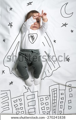 Cute infant baby boy with a cape as a superhero sketch - stock photo