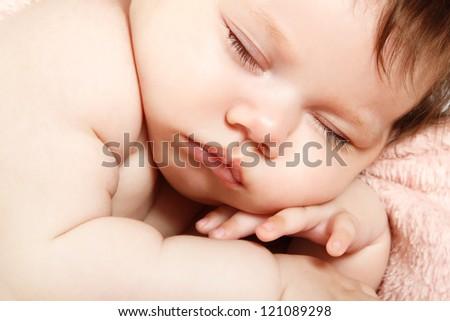 cute infant baby sleeping, beautiful kid's face closeup - stock photo