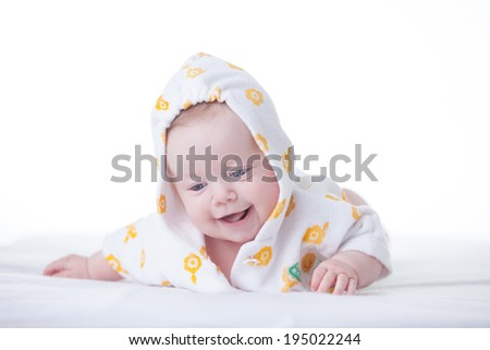 Cute infant girl in hood on white background