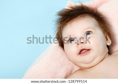 cute infant smiling, beautiful kid's face closeup - stock photo