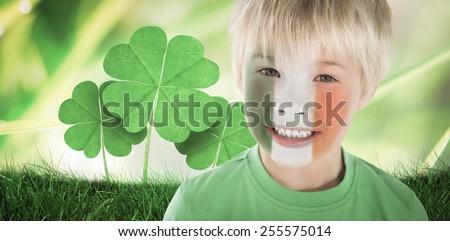 Cute irish boy against dew on the grass close up - stock photo