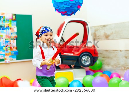 cute kid, boy dressed like pirate on playground - stock photo