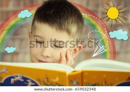 Cute kid boy is reading a book