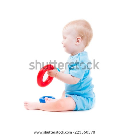 cute kid boy playing with rings