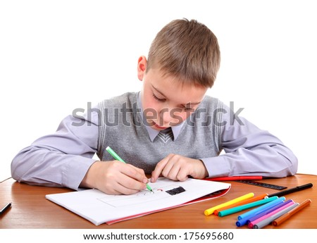 Cute Kid Drawing at the School Desk Isolated on the White Background - stock photo