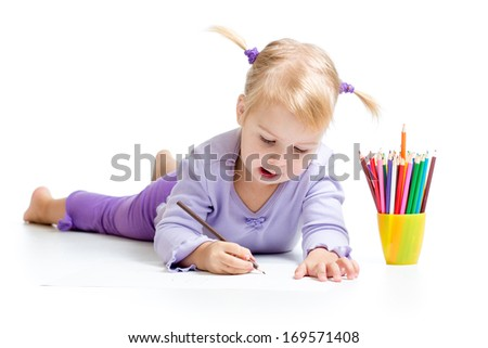 Cute kid drawing with color pencils - stock photo