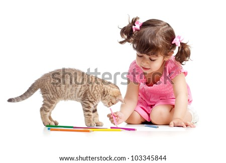 Cute kid drawing with pencils. Kitten next to girl. - stock photo