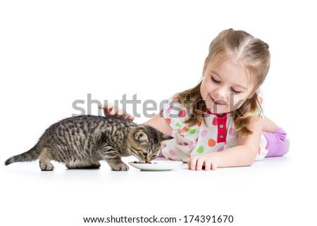 cute kid girl feeding kitten - stock photo