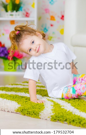 Cute kid girl playing in the room - stock photo