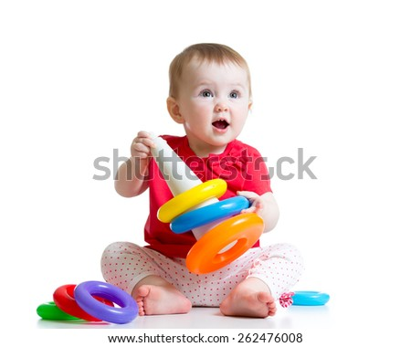 cute kid girl playing with color pyramid toy - stock photo