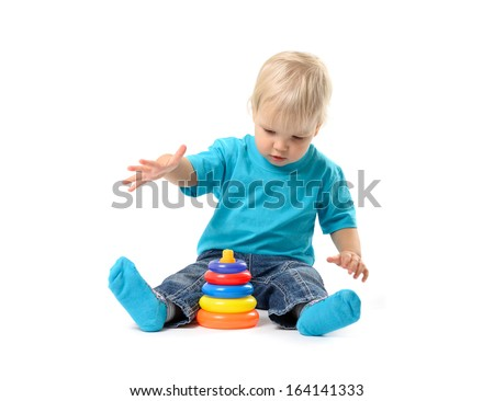 Cute kid girl playing with educational toy isolated on white background
