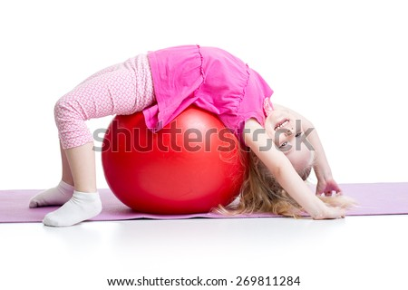Cute kid girl stretching on pilates fitness ball