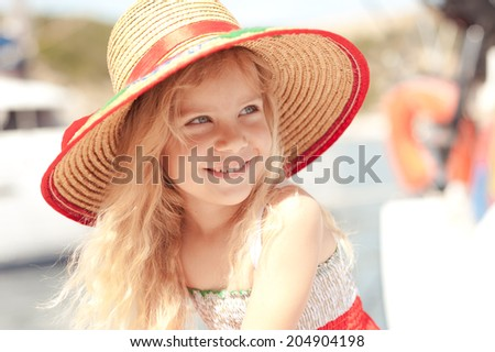 Cute kid girl wearing hat outdoors - stock photo