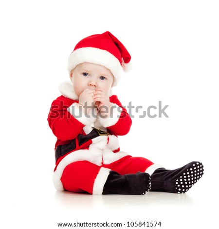 cute kid in Santa Claus clothes - stock photo