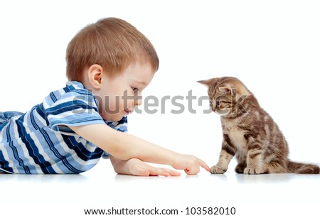 cute kid lying on floor and playing with cat pet - stock photo