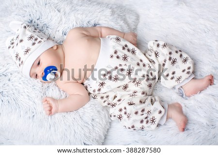 cute kid lying on his back. the baby is sleeping - stock photo