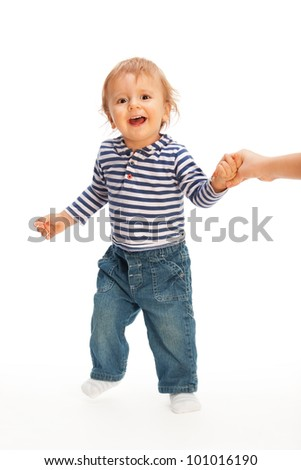 Cute kid pulling parent's hand and smiling with open mouth - stock photo