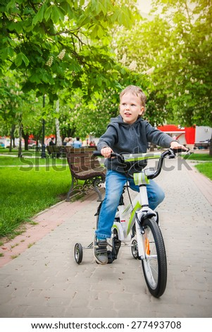 Cute kid riding a bicycle
