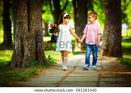 cute kid walking together in summer park
