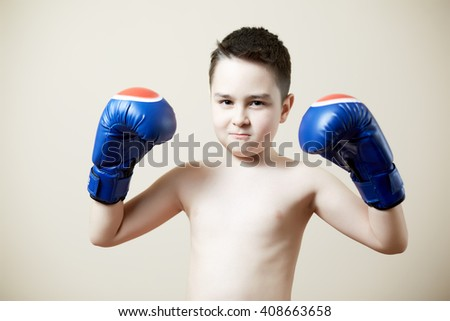 cute kid with boxing gloves