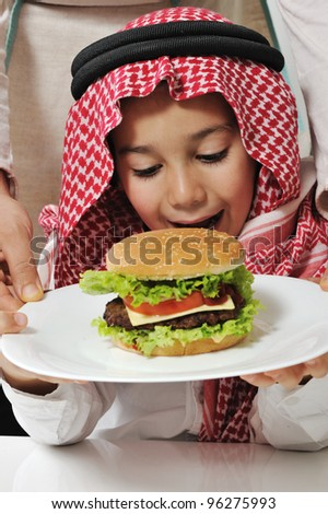 Cute kid with cheeseburger