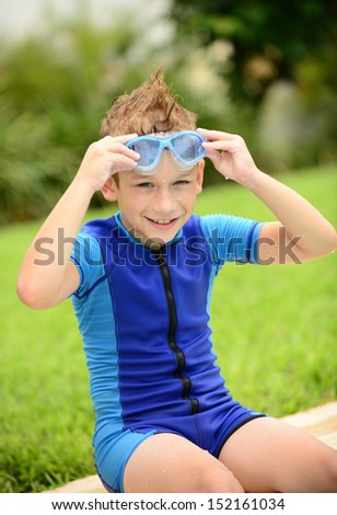 cute kid with goggles and wetsuit in summer - stock photo