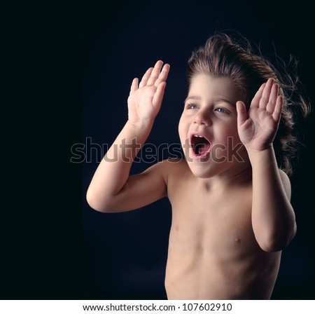 cute kid with surprised expression acting funny - stock photo