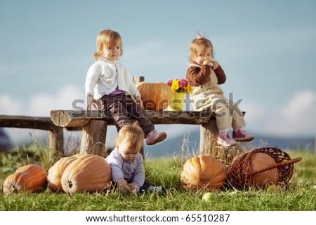 Cute kids having fun at countryside - stock photo