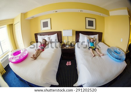 Cute kids in a hotel room while on fun family vacation - stock photo