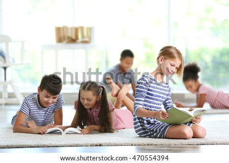 Cute kids reading books at home