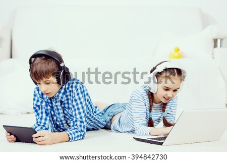 Cute kids using devices  - stock photo