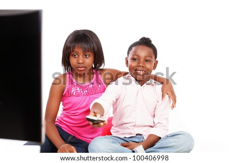 Cute kids watching TV, the image is in horizontal with copy space