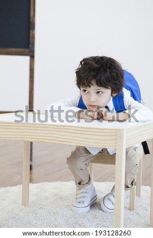 Cute Korean boy at desk