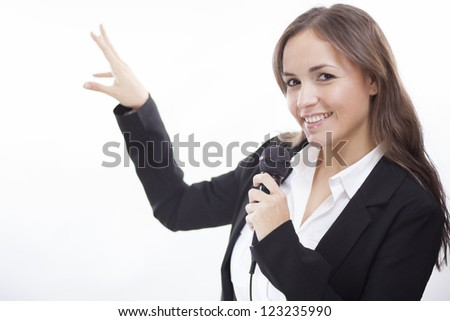 Cute latin business woman presenting a new product - stock photo