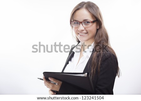 Cute latin business woman smiling and holding a file - stock photo