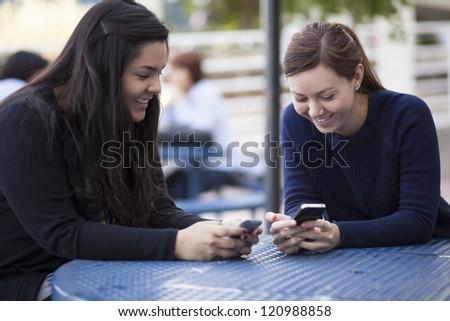 Cute latin friends having fun at school - stock photo