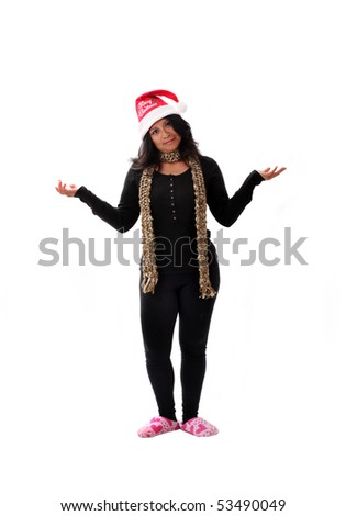 cute latina girl in a santa hat and pink slippers - stock photo
