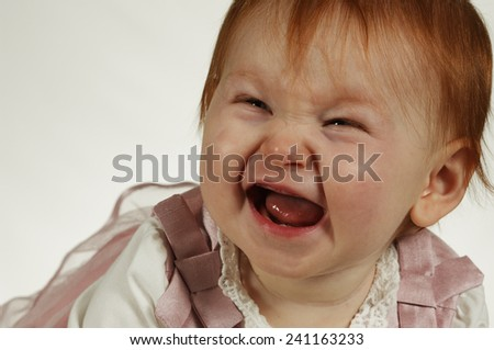 Cute laughing baby girl