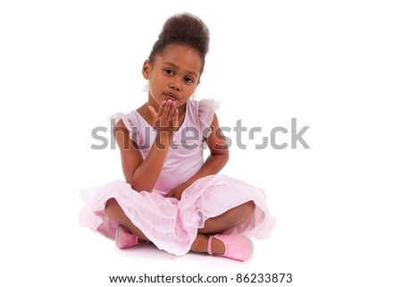 Cute little African Asian girl sitting on the floor,  isolated on white background