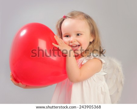 cute little angel-girl with red heart - stock photo