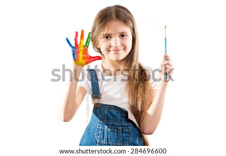 Cute little artist girl showing painted hands - stock photo