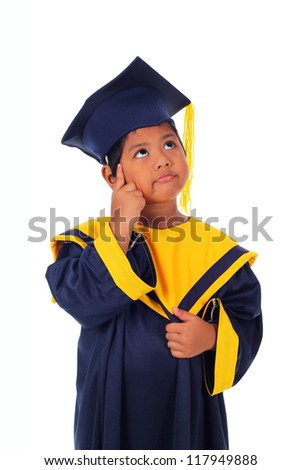 Cute little asian boy in graduation gown thinking action isolated on white