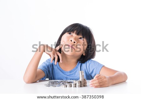 Cute Little asian girl and pile coin for saving. money concept  in thinking action with white background