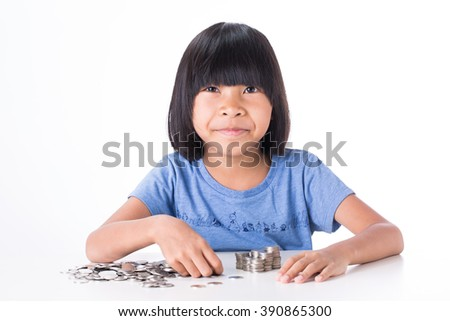 Cute Little asian girl and pile coin for saving. money concept with white background