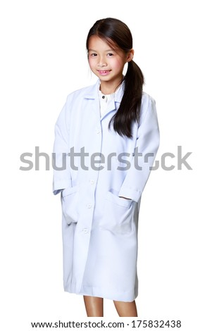 Cute little asian girl dressed like a doctor, Isoated over white - stock photo