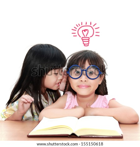Cute little asian girl whispering something to her sister get idea - stock photo